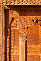 Intricately carved sandstone walls in Fatehpur Sikri, Uttar Pradesh, India.