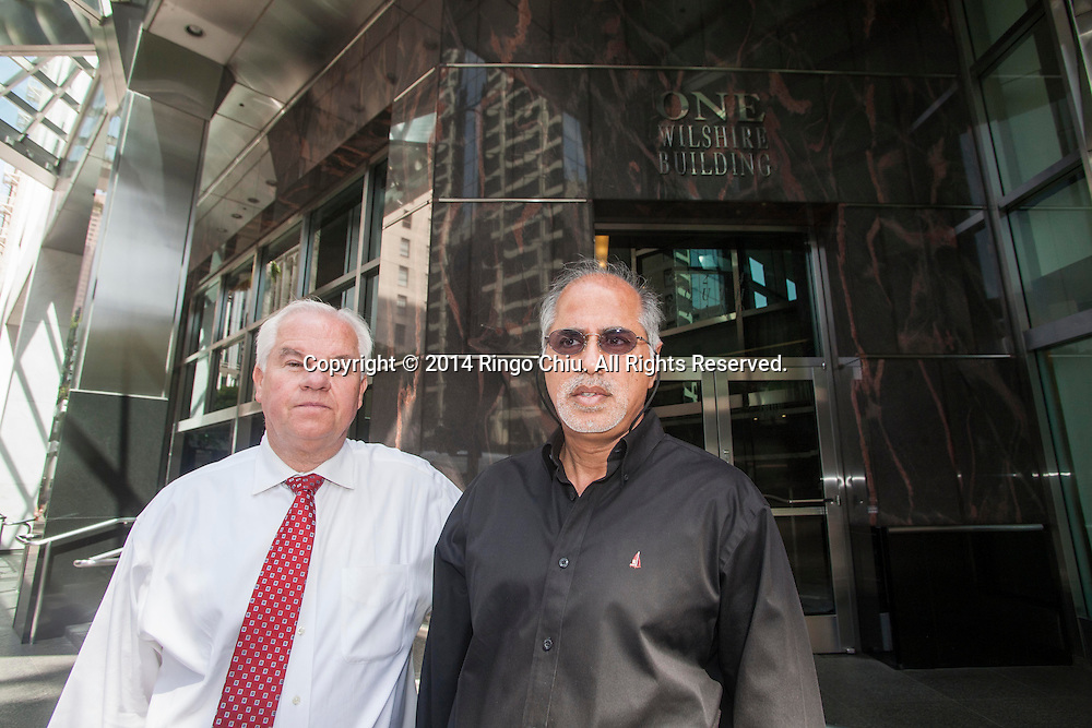 Max McCombs, left, and Navroz Haji, founders of U.S. Colo, in front of the One Wilshire building downtown. (Photo by Ringo Chiu/PHOTOFORMULA.com)