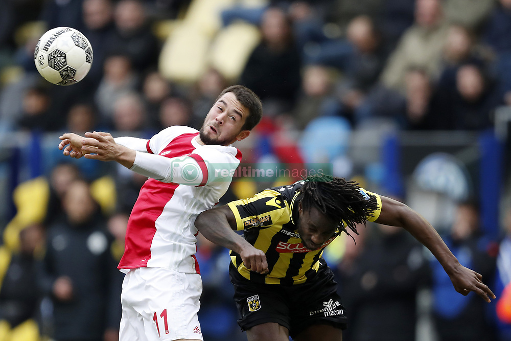 (L-R) Amin Younes of Ajax, Fankaty Dabo of Vitesse during the Dutch Eredivisie match between Vitesse Arnhem and Ajax Amsterdam at Gelredome on March 04, 2018 in Arnhem, The Netherlands