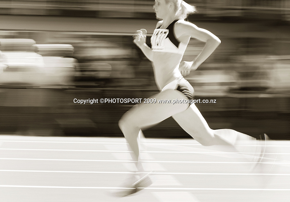 Auckland's Monique Williams flies down the home straight in the women's 400m final.<br /> National athletics championships, Day Two at Newtown Park, Wellington. Friday, 27 March 2009. Photo: Dave Lintott/PHOTOSPORT
