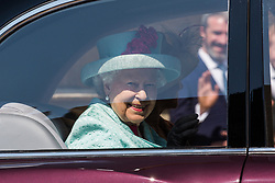 Windsor, UK. 21st April 2019. The Queen smiles as she leaves St George's Chapel in Windsor Castle following the Easter Sunday service.