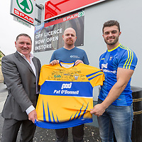 Gerry Gerraghty and Clare Senior Hurler Jason McCarthy present the competition winner with a signed Clare Jersey to Pat Boyle