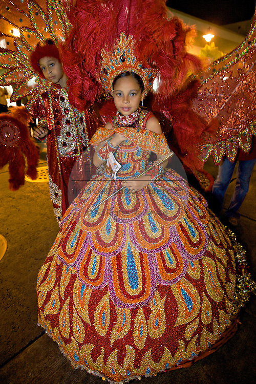 A costumed beauty queen dances in the streets during the Carnaval de Ponce February 20, 2009 in Ponce, Puerto Rico.