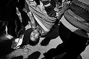 Stone belting in Srinagar, after the Eid Prayer at the  Srinagar Martyr's Graveyard on 17, November 2010..Younge boy was wounded in the head by the explosion of a tear by the Indian Army....
