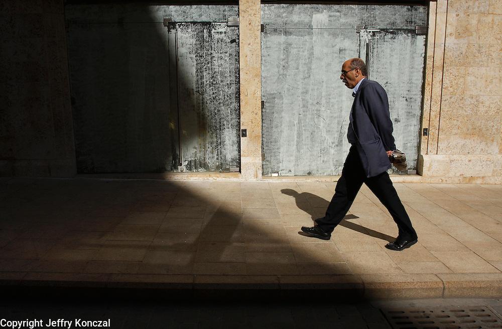 A man walks along a sidewalk in Beirut, Lebanon.