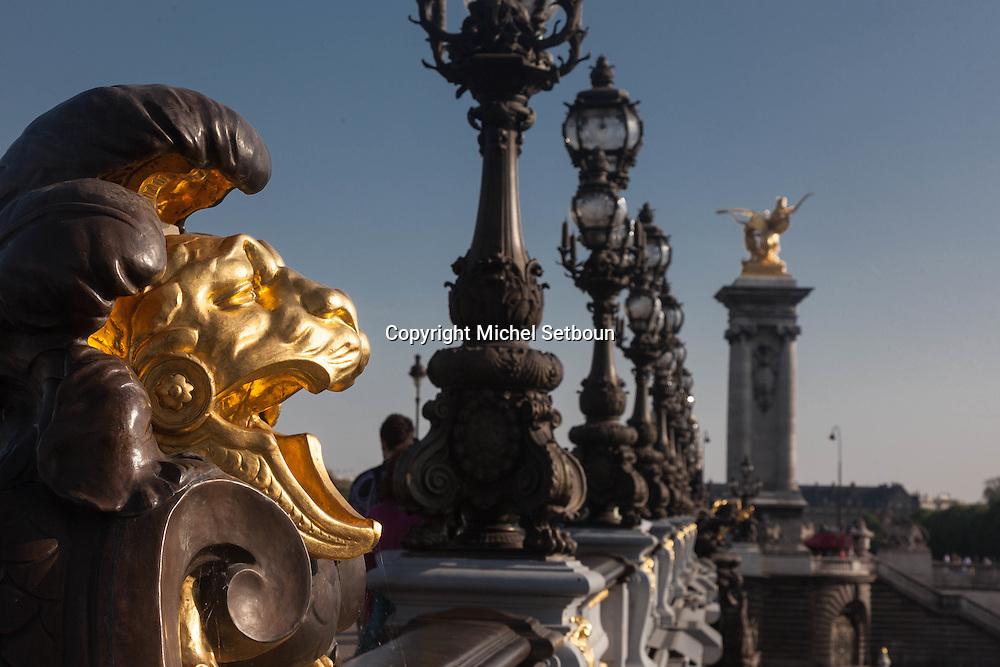 France. Paris the nymphs of the seine  on Pont Alexandre-III bridge, gold statue. Seine River / les nymphes de la seine,  Le pont Alexandre III 3, , les statues dorees, Les ponts sur la seine,