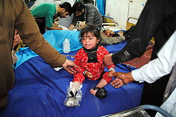 61017760<br /> An injured girl receives medical treatment at a hospital in northwest Pakistan s Peshawar on Feb. 4, 2014. At least eight people were killed and 25 others injured on Tuesday evening as a blast hit a busy market in Peshawar, local media reported, Tuesday, 4th February 2014. Picture by  imago / i-Images<br /> UK ONLY
