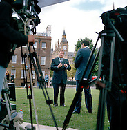 UK. London. From a story on Abingdon Street Gardens, a small patch of land, often referred to as College Green, that lies next to The Houses of Parliament in Westminster. It is a place where the media and the politicians come face to face. Interviews are held, photo shoots are set up and bewildered tourists stroll by..Photo shows Former Deputy Prime Minister John Prescott talking to the BBC on the day Gordon Brown took over as British Prime Minister..Photo©Steve Forrest/Workers Photos s