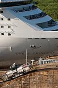 Cruise ship and locomotive at Miraflores Locks. Panama Canal, Panama City, Panama, Central America.