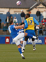 Photo: Steve Bond/Sportsbeat Images.<br /> Macclesfield Town v Hereford United. Coca Cola League 2. 26/12/2007. Luke Dimech (L) cannot stop Trevor Benjamin (R) getting in a header