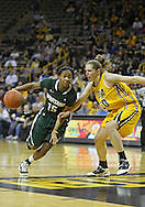 January 27 2010: Michigan St. forward Cetera Washington (15) drives past Iowa forward Kelly Krei (20) during the second half of an NCAA women's college basketball game at Carver-Hawkeye Arena in Iowa City, Iowa on January 27, 2010. Iowa defeated Michigan State 66-64.