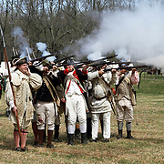A re-enactment of the American Revolution's Continental Army firing its muskets in Jockey Hollow National Park, New Jersey, USA. Parts of the Continental Army wintered in Jockey Hollow in 1779-1782.<br />