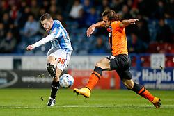 Harry Bunn of Huddersfield Town shoots past Joe Bennett of Brighton - Photo mandatory by-line: Rogan Thomson/JMP - 07966 386802 - 21/10/2014 - SPORT - FOOTBALL - Huddersfield, England - The John Smith's Stadium - Huddersfield Town v Brighton & Hove Albion - Sky Bet Championship.