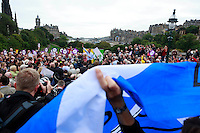 A member of the public with a Yes flag while Jim Murphy in his speech.<br /> MP to resume referendum campaign tour. Jim Murphy to make the case for the United Kingdom during his 100 Streets in 100 Days project<br /> Pako Mera/Universal News And Sport (Europe) 02/09/2014