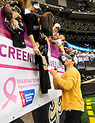 "New Orleans Saints QB Drew Brees signs autographs for fans in front of the Breast Cancer Screening Banner prior to the game against the Carolina Panthers Sunday Oct. 3,2010. The NFL has gone ""Pink"" for October in honor of Breast Cancer Awarness. The Saints went on to win 16-14. John Carney kicked three field goals to help the Saints win.PHOTO©SuziAltman.com"