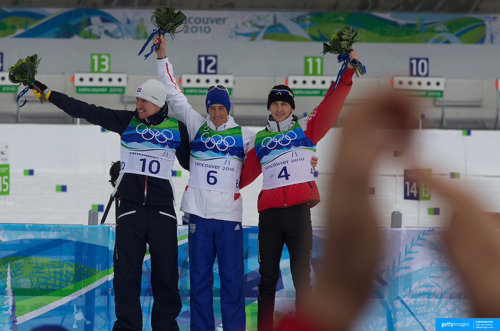 Winter Olympics, Vancouver, 2010.Medal winners Emil Hegle Svendsen. Norway,  (left), Vincent Jay, France,, (centre, gold), and Jakov Fak, Croatia,  (right)  after the Men's 10km KM Biathlon at The Whistler Olympic Park, Whistler, during the Vancouver  Winter Olympics. 14th February 2010. Photo Tim Clayton