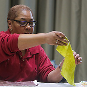 "Althea Johnson straightens a quilt square during ""Create Your Own Quilt Squares"" Sunday November 23, 2014 at the Cameron Art Museum in Wilmington, N.C. (Jason A. Frizzelle)"