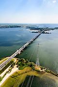 Nederland, Zuid-Holland, Numansdorp 10-06-2015; Haringvlietbrug gezien naar Hellegatsplein met rijksweg A29. Verbindt de Hoeksche Waard met Goeree-Overflakkee.<br /> Bridge crossing Haringvliet estuary.<br /> luchtfoto (toeslag op standard tarieven);<br /> aerial photo (additional fee required);<br /> copyright foto/photo Siebe Swart