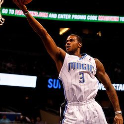 March 11, 2012; Orlando, FL, USA; Orlando Magic forward Earl Clark (3) with a layup during the first quarter of a game against the Indiana Pacers at  Amway Center.   Mandatory Credit: Derick E. Hingle-US PRESSWIRE