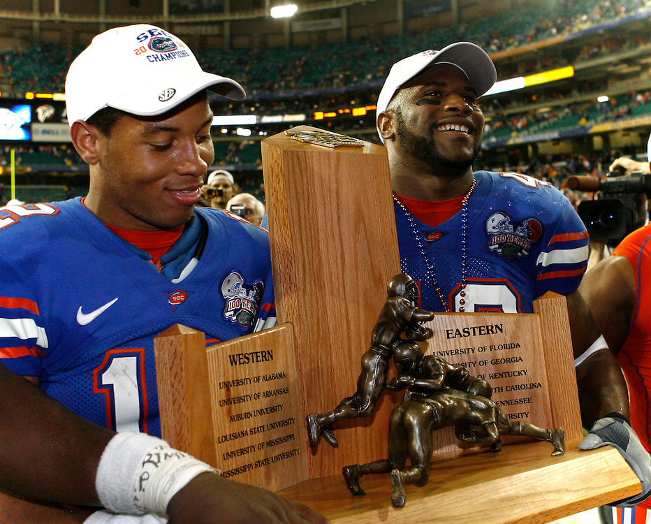 Florida QB Chris Leak and LB Brandon Siler carry the SEC trophy around the field after the SEC Championship game between the Arkansas Razorbacks and the Florida Gators at the Georgia Dome in Atlanta, GA on December 2, 2006.<br />
