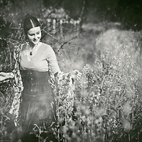 atmospheric photo of beautiful young caucasian woman smiling in retro style