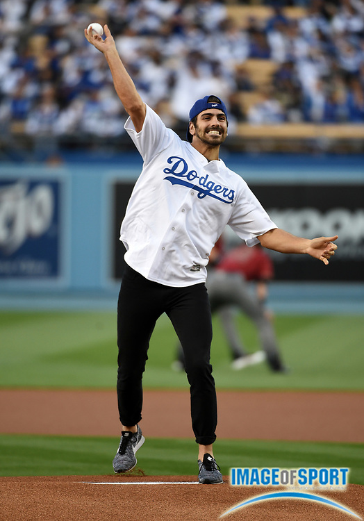 Apr 13, 2016; Los Angeles, CA, USA; America's Next Top Model winner and deaf Dancing with the Stars contestant Nyle DiMarco throws out the ceremonial first pitch before a MLB game between the Arizona Diamondbacks and the Los Angeles Dodgers at Dodger Stadium.