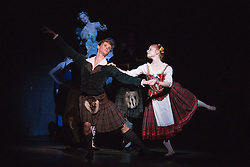 © Licensed to London News Pictures. 04/08/2015. London, UK. Luke Schaufuss as James and Mia Heathcote as Effie. Dress rehearsal of La Sylphide (some parts in partial costume). Australia's Queensland Ballet makes its London Coliseum debut with La Sylphide, the August Bournonville ballet is choreographed by Peter Schaufuss. Performances at the Coliseum from 5 to 8 August 2015. Photo credit: Bettina Strenske/LNP