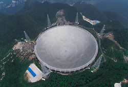 PINGTANG, Sept. 7, 2016 (Xinhua) -- Photo taken on Sept. 7, 2016 shows the Five-hundred-meter Aperture Spherical Telescope (FAST) in Pingtang County, southwest China's Guizhou Province. The FAST, world's largest radio telescope, is expected to be put into operation at the end of September. (Xinhua/Liu Xu) (wyl) (Credit Image: © Li Xu/Xinhua via ZUMA Wire)