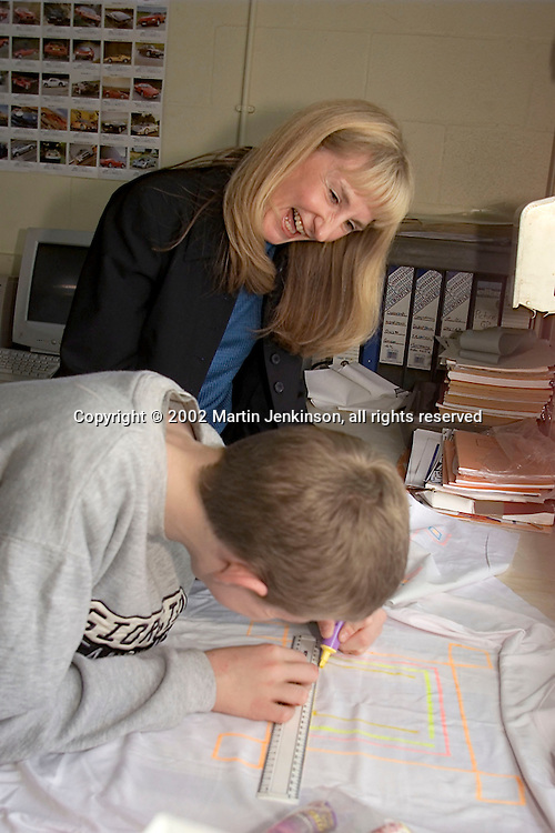 Teacher laughing with a pupil as he creates adesign on a t-shirt...© Martin Jenkinson, tel/fax 0114 258 6808 mobile 07831 189363 email martin@pressphotos.co.uk. Copyright Designs & Patents Act 1988, moral rights asserted credit required. No part of this photo to be stored, reproduced, manipulated or transmitted to third parties by any means without prior written permission