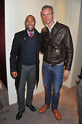 Left to right, COLIN JACKSON and MARK FOSTER at a reception to unveil the ISAF World Match Racing Tour Championship Trophy at Garrard, 24 Albemarle Street, London W1 on 7th November 2011.