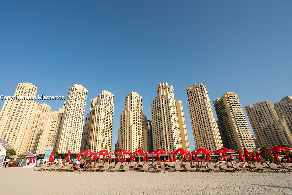 View of beach and high rise apartment building at The Beach in Jumeirah Beach  district of modern Dubai, UAE, United Arab Emirates.