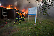London 8th September 2012: A fire breaks out in the empty buildings of a former primary school called Bessemer Grange, off Denmark Hill in the south London borough of Southwark. The former pre-school structure was eventually gutted after six fire engines and 30 firefighters  of the London Fire Brigade ?arrived to douse the flames which had already taken hold of the prefabricated structure. Bessemer Grange junior school and the current nursery occupies a location across the road and is on the former site of Victorian iron magnate, Henry Bessemer's mansion.