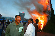 ADDIS ABABA, ETHIOPIA..09/26/2002.Meskal Festival..Orthodox priests and about 300.000 worshippers from all over the country meet at Meskal Square to sing, dance and celebrate during the country's largest religious procession..At sunset, a pile of dry wood in the middle of the square is set ablaze by the patriarch and the highest priests of the country to mark the climax and end of the ceremony..(Photo by Heimo Aga)