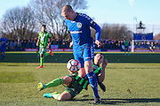 AFC Wimbledon defender Barry Fuller (2) tackles Curzon Ashton defender Jonathan Hunt (5)  during the The FA Cup match between Curzon Ashton and AFC Wimbledon at Tameside Stadium, Ashton Under Lyne, United Kingdom on 4 December 2016. Photo by Simon Davies.