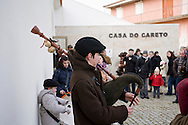 Young boy playing bagpipes in Podence carnival, Macedo de Cavaleiros Portugal