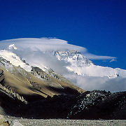 Lenticular clouds engulf the North Face of Mount Everest, Tibe (China), as seen from Rongbuk Basecamp.