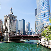 Photo of Chicago skyline at Michigan Avenue Bridge (DuSable Bridge) in downtown Chicago with the Chicago River, London Guarantee Building, Leo Burnett Building, United Airlines Building, and Trump Tower.
