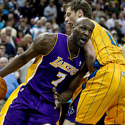 February 5, 2011; New Orleans, LA, USA; Los Angeles Lakers power forward Lamar Odom (7) drives past New Orleans Hornets center David Andersen (11) during the fourth quarter at the New Orleans Arena. The Lakers defeated the Hornets 101-95.  Mandatory Credit: Derick E. Hingle