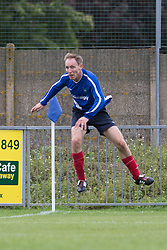 © Licensed to London News Pictures . 22/09/2013 . Lancing , UK . JIM MURPHY , Shadow Secretary of State for Defence and Member of Parliament for East Renfrewshire jumps in the air during the Labour Party vs journalists football match . Day 1 of the Labour Party 's annual conference in Brighton . Photo credit : Joel Goodman/LNP