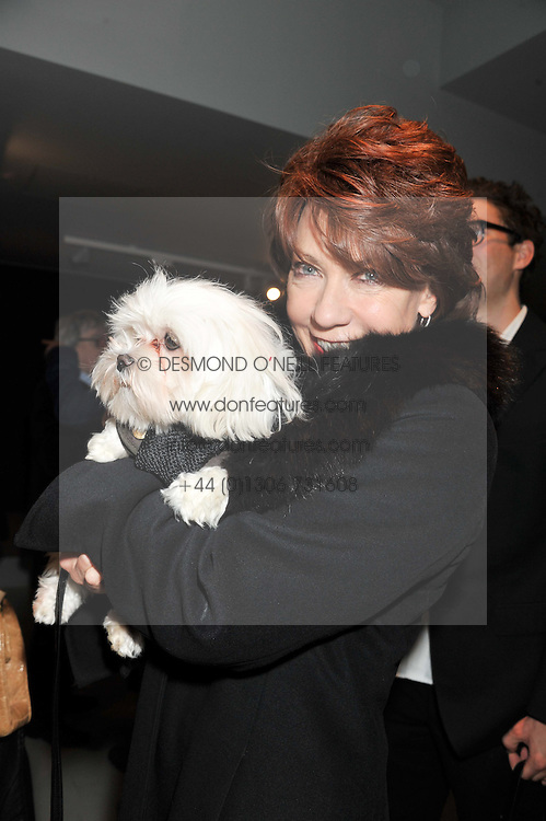 KATHY LETTE and dog Frankie Benett at a private view of Bill Wyman - Reworked held at the Rook & Raven Gallery, 7 Rathbone Place, London W1 on 26th February 2013.
