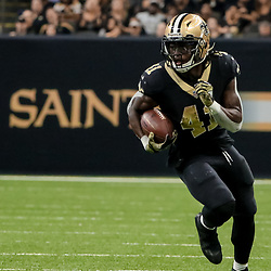 Nov 5, 2017; New Orleans, LA, USA; New Orleans Saints running back Alvin Kamara (41) runs after a catch for a 33-yard touchdown against the Tampa Bay Buccaneers during the first half of a game at the Mercedes-Benz Superdome. Mandatory Credit: Derick E. Hingle-USA TODAY Sports