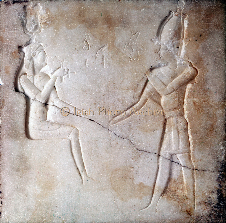 Isis and Osiris, Ancient Egyptian gods, parents of the falcon god Horus. Bas-relief, Ptoelmaic period.