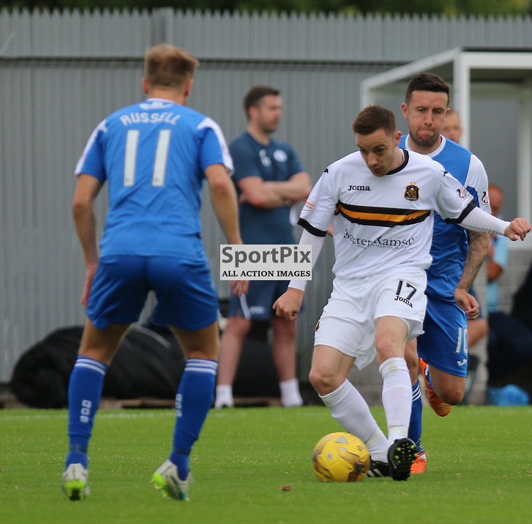 Jon Routledge under pressure during the Dumbarton FC V Queen of the South FC Scottish Championship 22th August 2015 <br /> <br /> (c) Andy Scott | SportPix.org.uk