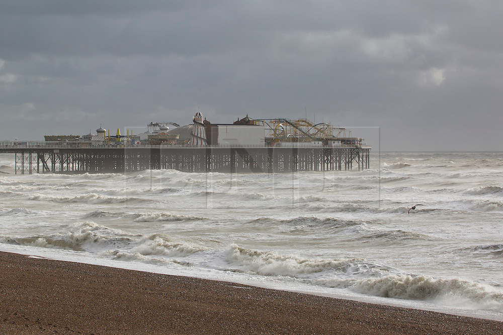 Brighton, UK. 22/11/2016, Strong wind and powerful waves are hitting the beach in Brighton as dark clouds are looming on the horizon. Photo Credit: Hugo Michiels