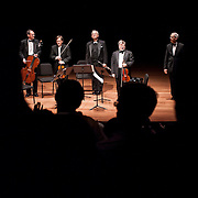 March 30, 2012 - New York, NY : From left, cellist Timothy Eddy, violinist Todd Phillips, clarinetist David Shifrin, violinist Daniel Phillips, and violist Steven Tenenbom take a curtain call after performing Wolfgang Amadeus Mozart's 'Quintet in A major for Clarinet, Two Violins, Viola, and Cello, K. 581 (1789)'  in the Chamber Music Society's presentation of 'Great Clarinet Quintets,'  in Alice Tully Hall at Lincoln Center on Friday evening. CREDIT : Karsten Moran