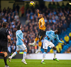 MANCHESTER, ENGLAND - Saturday, November 28, 2009: Manchester City's Emmanuel Adebayor and Hull City's Kamil Zayatte during the Premiership match at the City of Manchester Stadium. (Photo by David Rawcliffe/Propaganda)