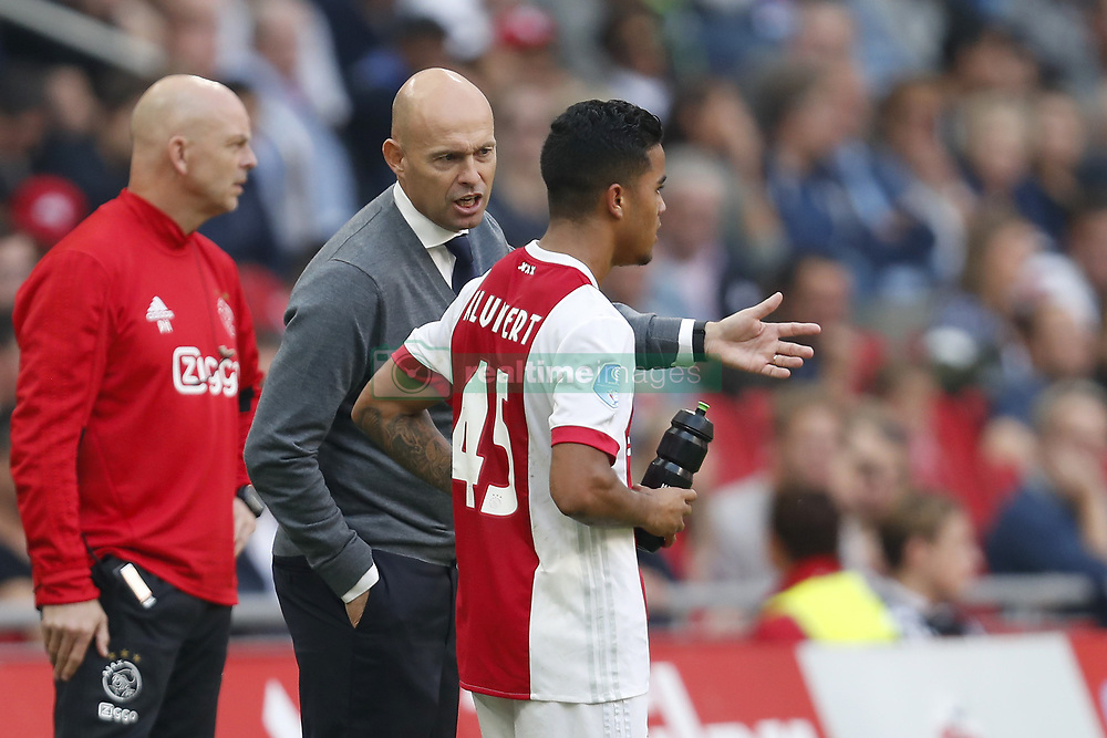(L-R) coach Marcel Keizer of Ajax, Justin Kluivert of Ajax during the Dutch Eredivisie match between Ajax Amsterdam and Vitesse Arnhem at the Amsterdam Arena on September 24, 2017 in Amsterdam, The Netherlands