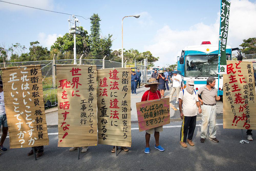 OKINAWA, JAPAN - AUGUST 19 : Anti U.S base protesters with written signs to protest against the construction of helipads in front of the main gate of U.S. military's Northern Training Area in the village of Higashi, Okinawa Prefecture, on August 19, 2016. Japanese government resume construction of total six helipads in a fragile ten million year old Yanbaru forest that is home to endemic endangered species such as the Okinawan rail and Okinawa wood pecker. (Photo by Richard Atrero de Guzman/NURPhoto)