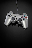 Video game controller on black background