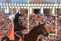 The Virginia Cavalier mascot energies the home crowd on top of his horse, Sabre.  The Virginia Tech Hokies defeated The Virginia Cavaliers 52-14 on November 19, 2005 at Scott Stadium in Charlottesville, VA.